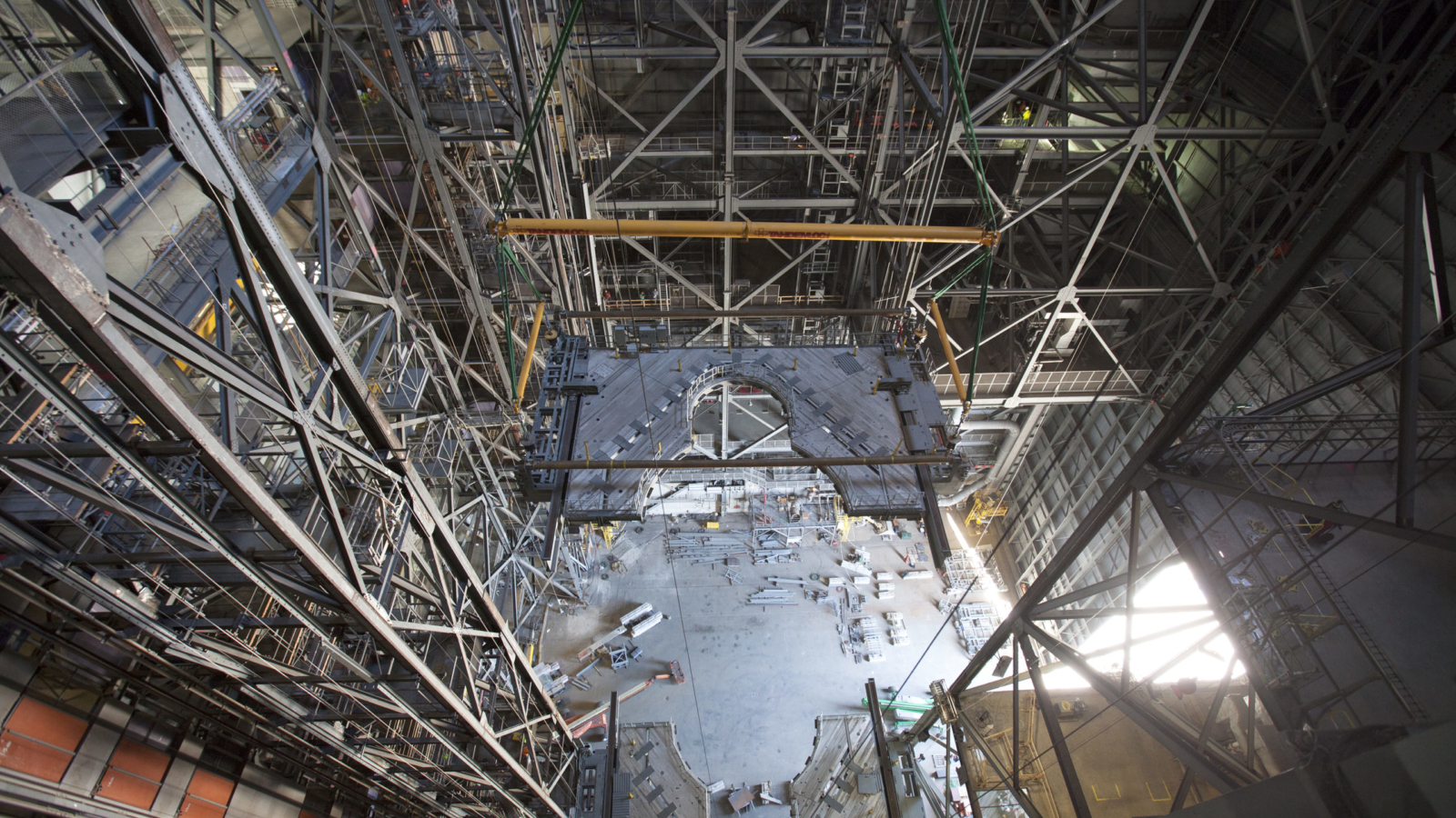 Photos of Platform K(2) being lifted and installed into Highbay 3 inside the VAB.